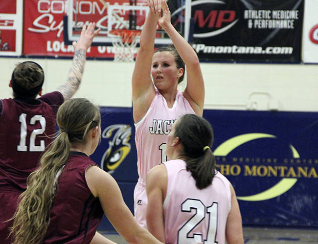 In this Feb. 15, 2014 photo provided by Montana State University Billings, Montana State Billings forward Quinn Peoples, back right, takes a shot during her team's Think Pink Night against Central Washington, in Billings, Mont. Peoples played in the NCAA Division II tournament in Pomona, Calif., with the encouragement of her 23-year-old sister Mairissa. Mairissa died of cancer on March 13, a day after Quinn left for the tournament