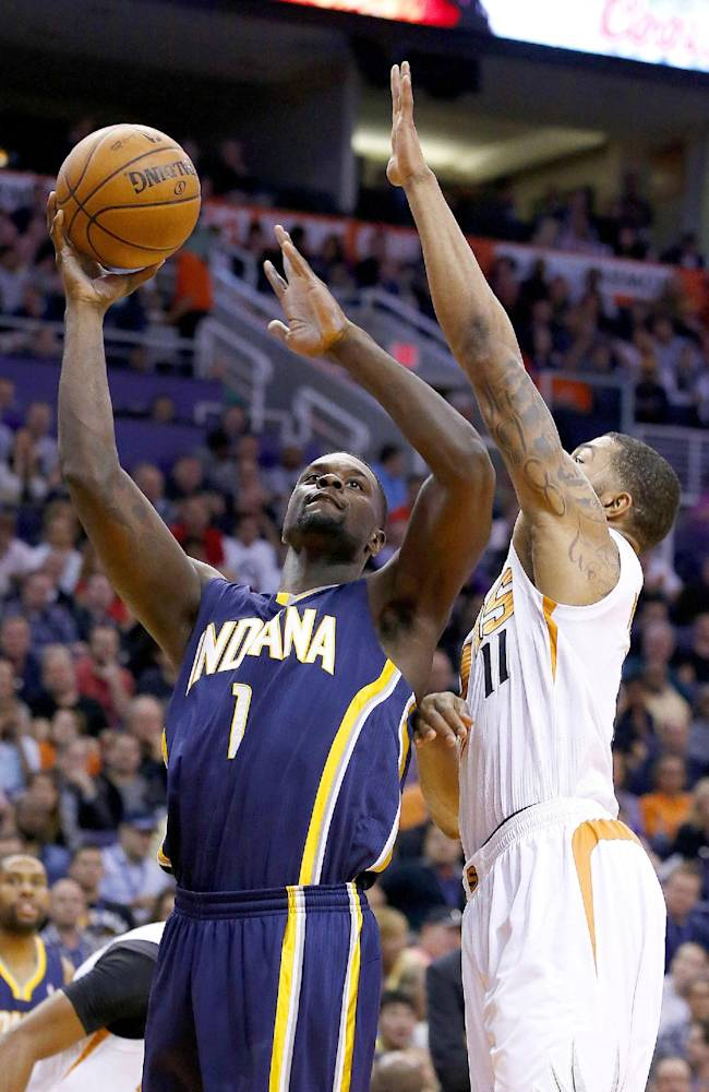 Indiana Pacers' Lance Stephenson (1) goes up for a shot against Phoenix Suns' Markieff Morris (11) during the first half of an NBA basketball game Wednesday, Jan. 22, 2014, in Phoenix