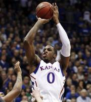 Kansas forward Thomas Robinson (0) shoots over Kansas State guard Will Spradling (55) during the first half of an NCAA college basketball game in Lawrence, Kan., Wednesday, Jan. 4, 2012. (AP Photo/Orlin Wagner)