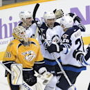 Winnipeg Jets right wing Devin Setoguchi (40) celebrates with Mark Scheifele (55) and Blake Wheeler (26) after Setoguchi scored a goal against Nashville Predators goalie Carter Hutton (30) in the third period of an NHL hockey game on Saturday, March 1, 20