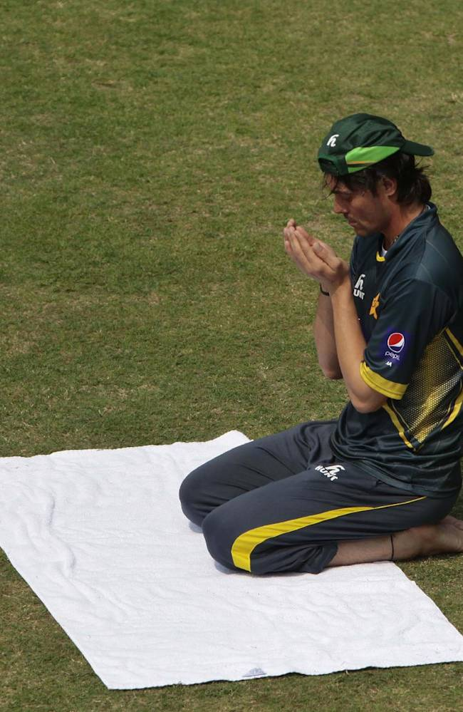 Pakistan's Anwar Ali prays on the ground during a practice session ahead of the Asia Cup tournament in Dhaka, Bangladesh, Monday, Feb. 24, 2014. Pakistan plays Sri Lanka in the opening match of the five nation one day cricket event that begins Tuesday