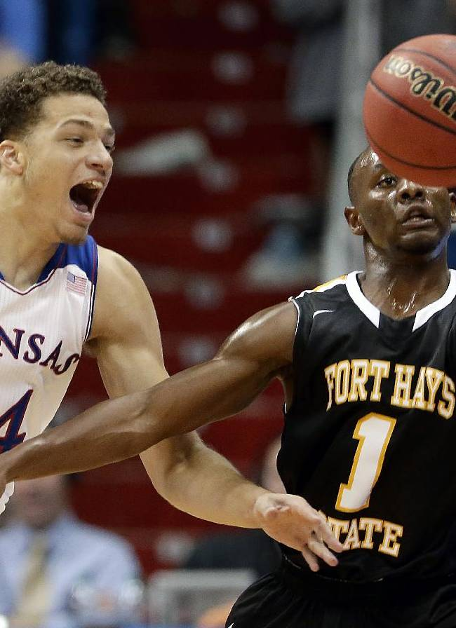 Kansas' Brannen Greene (14) and Fort Hays State's Achoki Moikobu (1) chase a loose ball during the first half of an exhibition NCAA college basketball game Tuesday, Nov. 5, 2013, in Lawrence, Kan