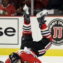 Chicago Blackhawks center Andrew Shaw falls down on the ice during the second period of a preseason NHL hockey game against the Montreal Canadiens in Chicago, Wednesday, Oct. 1, 2014. (AP Photo/Nam Y. Huh)