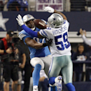 Dallas Cowboys outside linebacker Anthony Hitchens (59) gets hit in the back by a pass intended for Detroit Lions tight end Brandon Pettigrew (87) during the fourth quarter of an NFL wildcard playoff football game, Sunday, Jan. 4, 2015, in Arlington, Texa