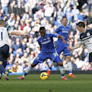 Chelsea's Samuel Eto'o, centre, controls the ball in front of Everton's Leon Osman, left, and Leighton Baines, right, during an English Premier League soccer match at the Stamford Bridge ground in London, Saturday, Feb. 22, 2014. Chelsea won the match 1-0