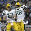 Green Bay Packers quarterback Aaron Rodgers (12) and Jermichael Finley (88) celebrate Finley's 20-yard touchdown reception against the Detroit Lions in the second quarter of an NFL game in Detroit, Sunday, Nov. 18, 2012. (AP Photo/Duane Burleson)