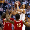 Tennessee's Cierra Burdick looks to the basket while defended by Rutgers' Rachel Hollivay, left, and Syessence Davis during their NCAA college basketball game in Knoxville, Tenn., Sunday, Dec. 30, 2012. Tennessee won 66-47. (AP Photo/The Knoxville News Sentinel, Saul Young)