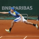 Jack Sock of the U.S. returns against Germany's Tommy Haas in their second round match at the French Open tennis tournament, at Roland Garros stadium in Paris, Friday, May 31, 2013. (AP Photo/Petr David Josek)