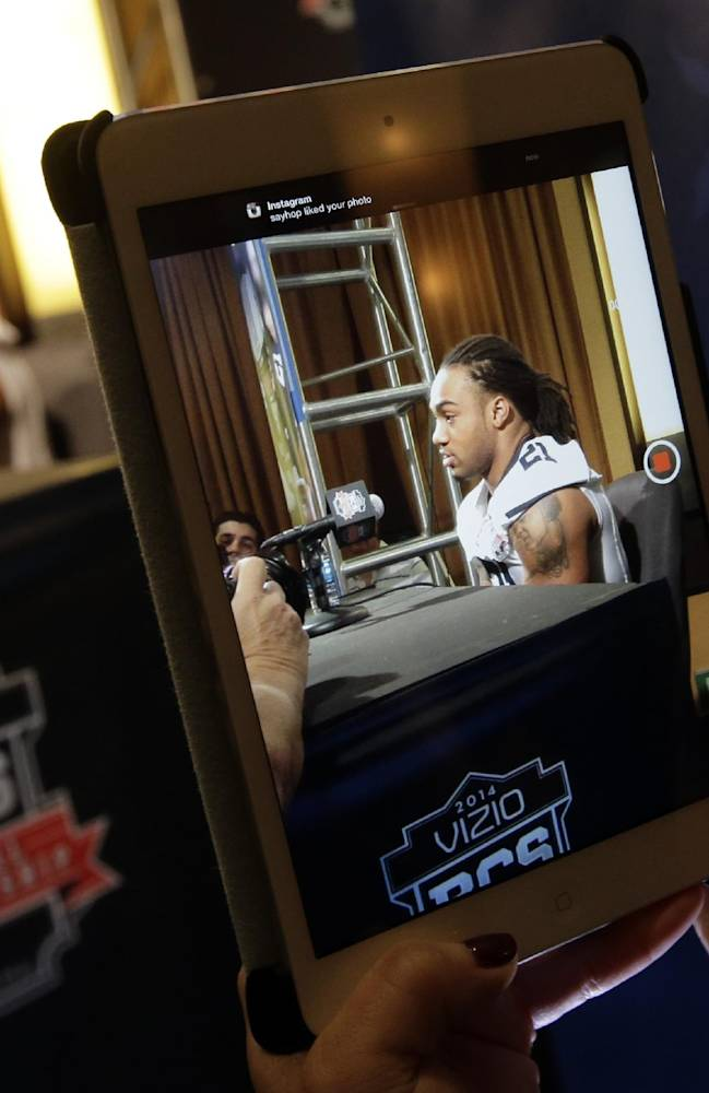 Auburn's Tre Mason is seen in a tablet as he answers a question during media day for the NCAA BCS National Championship college football game Saturday, Jan. 4, 2014, in Newport Beach, Calif. Florida State plays Auburn on Monday, Jan. 6, 2014