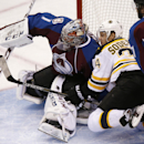 Boston Bruins Carl Soderberg, of Sweden, center, tumbles into Colorado Avalanche goalie Semyon Varlamov, of Russia, left, after being checked by Avalanche defenseman Brad Stuart in the first period of an NHL hockey game Wednesday, Jan. 21, 2015, in Denver