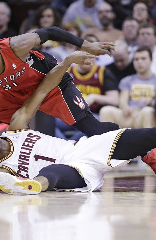Cleveland Cavaliers' Jarrett Jack (1) and Toronto Raptors' Terrence Ross (31) battle for a loose ball during the second quarter of an NBA basketball game, Tuesday, Feb. 25, 2014, in Cleveland