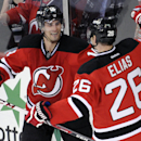 New Jersey Devils' Patrik Elias (26), of the Czech Republic, celebrates his empty-net goal with Adam Henrique during the third period of an NHL hockey game against the Columbus Blue Jackets, Thursday, Feb. 27, 2014, in Newark, N.J. The Devils won 5-2 The