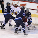 Arizona Coyotes' Oliver Ekman-Larsson (not shown) puts the puck past Winnipeg Jets' goaltender Ondrej Pavelec (31) with Jets' Ben Chiarot (63), Coyotes' Sam Gagner (9), Coyotes' Martin Hanzal (11) and Jets' Adam Lowry (17) in front of the net during firs
