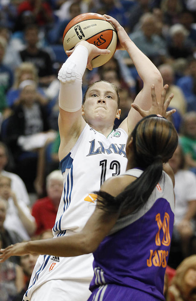 Minnesota Lynx guard Lindsay Whalen shoots against Phoenix Mercury guard Jasmine James (10) during Game 1 of the WNBA basketball playoffs Western Conference finals on Thursday, Sept. 26, 2013, in Minneapolis