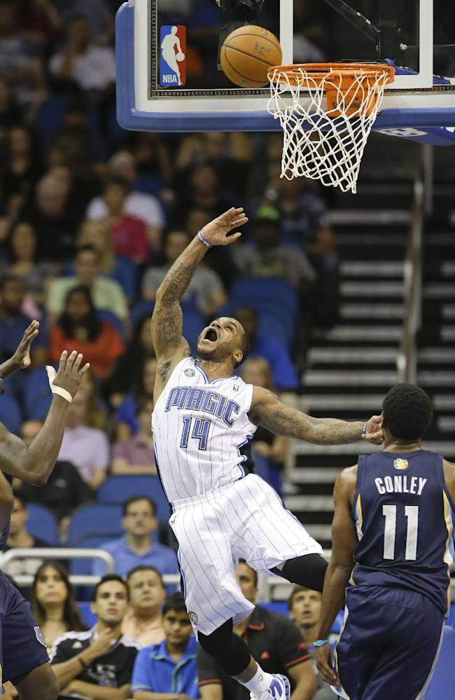 Orlando Magic's Jameer Nelson (14) makes a shot in front of Memphis Grizzlies' Mike Conley (11) during the first half of an NBA preseason basketball game in Orlando, Fla., Friday, Oct. 18, 2013