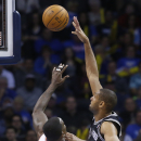 San Antonio Spurs forward Tim Duncan (21) shoots over Oklahoma City Thunder center Kendrick Perkins (5) in the first quarter of an NBA basketball game in Oklahoma City, Wednesday, Nov. 27, 2013 The Associated Press