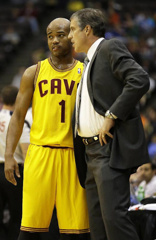 Washington Wizards head coach Randy Wittman, right, talks with Cleveland Cavaliers point guard Jarrett Jack (1) in the first half of an NBA preseason basketball game on Wednesday, Oct. 23, 2013, in Cincinnati