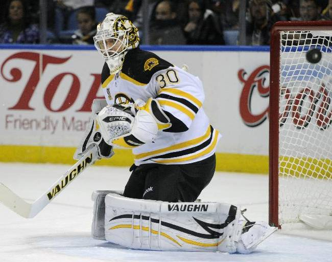 Boston Bruins goaltender Chad Johnson deflects the puck wide of the goal during the first period of an NHL hockey game against the Buffalo Sabres in Buffalo, N.Y., Wednesday, Oct. 23, 2013