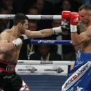 Carl Froch of Britain, left, fights against Mikkel Kessler of Denmark during their super-middleweight world title unification boxing match at O2 Arena in London, Sunday, May 26, 2013. (AP Photo/Sang Tan)