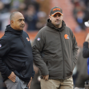 Cincinnati Bengals head coach Marvin Lewis, left, and Cleveland Browns head coach Mike Pettine watch their teams warm up before an NFL football game Sunday, Dec. 14, 2014, in Cleveland. (AP Photo/David Richard)