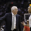 San Antonio Spurs coach Gregg Popovich, left, argues a call with official Danny Crawford, right, during the first half of Game 2 of the opening-round NBA basketball playoff series against the Dallas Mavericks, Wednesday, April 23, 2014, in San Antonio The