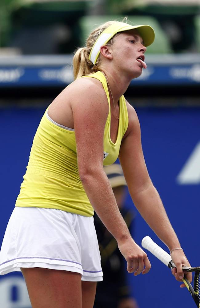 Coco Vandeweghe of the United States reacts after losing a point against Dominika Cibulkova of Slovakia during their second round match of the Japan Pan Pacific Open tennis tournament in Tokyo,Wednesday, Sept. 17, 2014