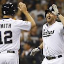 San Diego Padres' Chase Headley is greeted by Seth Smith after Headley drove in Smith with a two-run home run against the Detroit Tigers in the sixth inning of a baseball game Friday, April 11, 2014, in San Diego The Associated Press