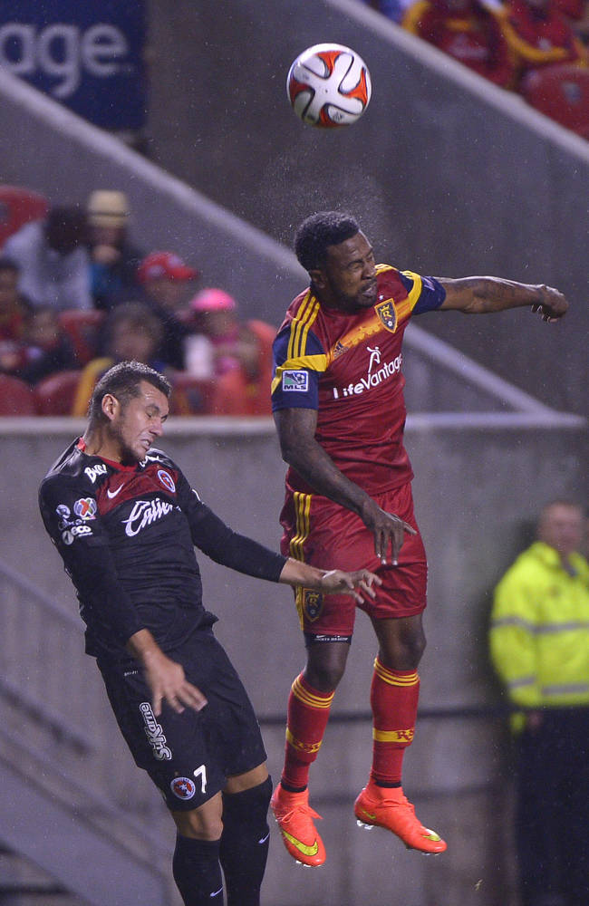 Real Salt Lake forward Robbie Findley (10) gets the header over Club Tijuana's defender Alejandro Molina. Mexican team Club Tijuana is tied 0-0 with Real Salt Lake after the first half of play, Tuesday, Aug. 12, 2014, at Rio Tinto Stadium in Sandy, Utah