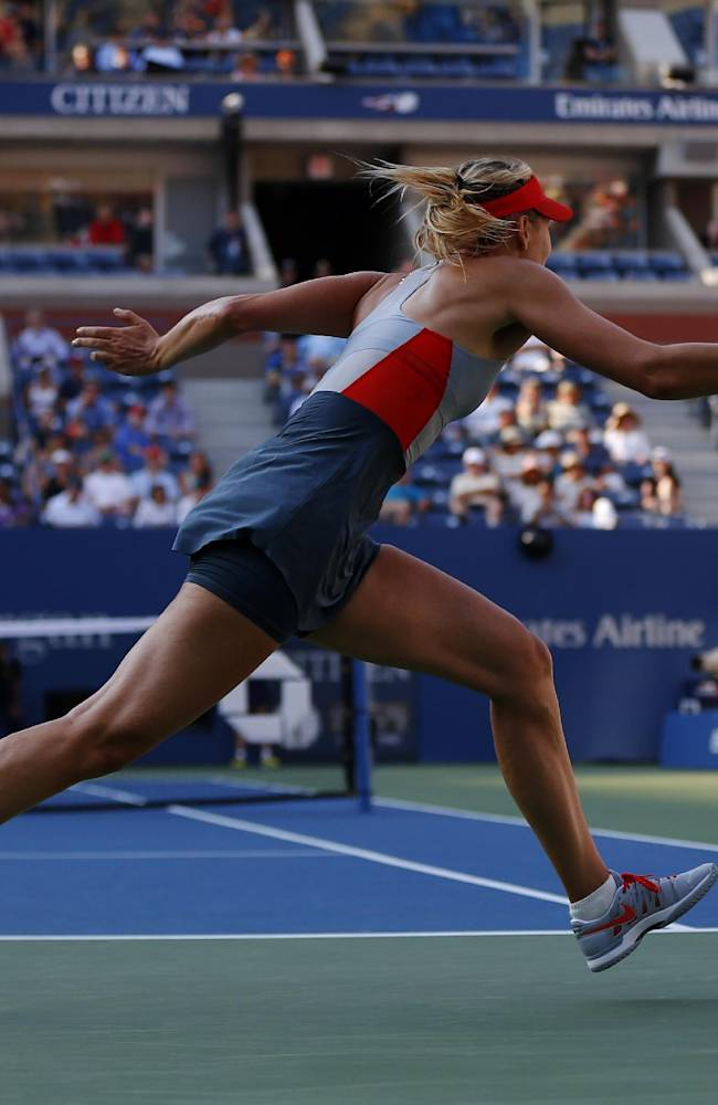 Maria Sharapova, of Russia, chases down a shot against Alexandra Dulgheru, of Romania, during the second round of the 2014 U.S. Open tennis tournament, Wednesday, Aug. 27, 2014, in New York