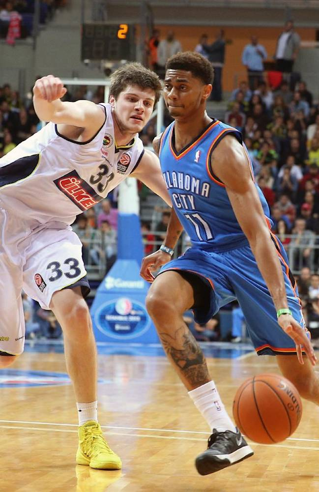 The NBA team Oklahoma City Thunder's Jeremy Lamb, right, attacks as James Metecan Birsen of Fenerbahce Ulker defends during a basketball game in Istanbul, Turkey, Saturday, Oct. 5, 2013. Oklahoma City Thunder has opened the preseason schedule with a game against the five-time Turkish champions at the Ulker Sports Arena.(AP Photo)
