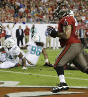 Tampa Bay Buccaneers tackle Donald Penn, right, catches a 1-yard pass for a touchdown against the Miami Dolphins during the first half of an NFL football game in Tampa, Fla., Monday, Nov. 11, 2013.(AP Photo/John Raoux)