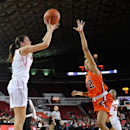 Georgia's Anne Marie Armstrong (3) shoots a 3-point basket while defended by Auburn's Tyrese Tanner (32) during the first half of an NCAA college basketball game in Athens, Ga., Thursday, Feb. 7, 2013. (AP Photo/AJ Reynolds)