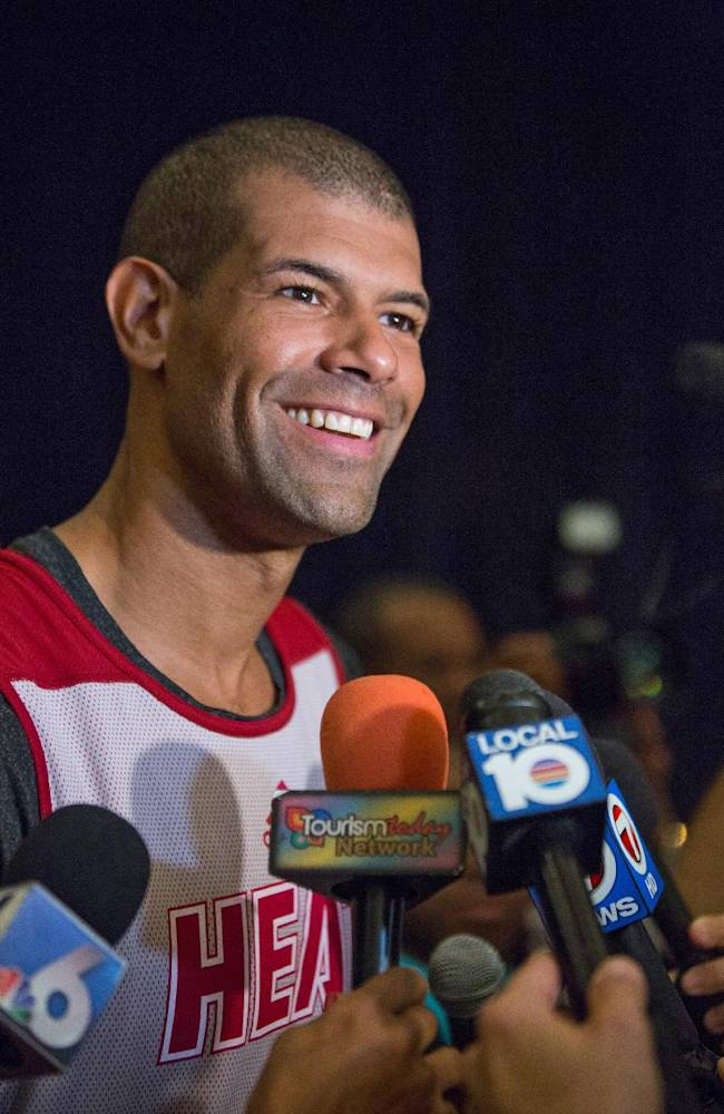 Miami Heat forward Shane Battier smiles as he speaks with reporters after training at the Atlantis resort on Paradise Island, Bahamas, Wednesday, Oct. 2, 2013. The two-time defending NBA champions are holding a one week training camp at the resort