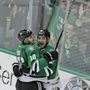Dallas Stars center Shawn Horcoff (10) celebrates his goal with teammate Colton Sceviour (22) during the second period of an NHL hockey game against the New Jersey Devils, Saturday, Dec. 13, 2014, in Dallas The Associated Press