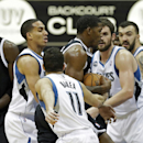 Brooklyn Nets' Kevin Garnett, left, looks on to see teammate Joe Johnson surrounded by Minnesota Timberwolves players including, from left, Kevin Martin, second from left, J.J. Barea, Kevin Love and Nikola Pekovic of Montenegro in the first quarter of an