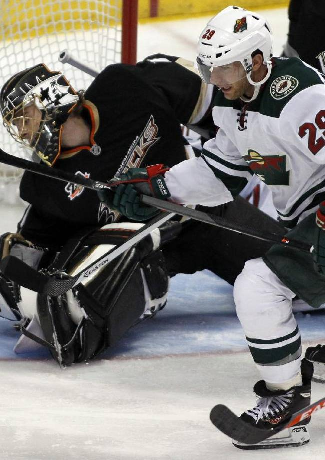 Minnesota Wild right wing Jason Pominville (29) scores against Anaheim Ducks goalie Jonas Hiller, left, of Switzerland in the third period of an NHL hockey game Wednesday, Dec. 11, 2013 in Anaheim, Calif. Ducks won 2-1
