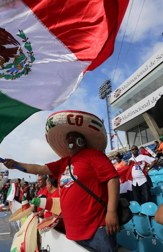Mexican fans sing the national anthem prior a Caribbean Series baseball game against Dominican Republic in Porlamar, Venezuela, Wednesday, Feb. 5, 2014