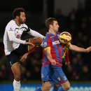 Tottenham Hotspur's Mousa Dembele, left, tussles with Crystal Palace's James McArthur during the English Premier League soccer match between Crystal Palace and Tottenham Hotspur at Selhurst Park, London, England, Saturday, Jan. 10, 2015
