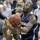 Notre Dame's Jerian Grant (22) goes up for a basket in front of Pittsburgh's Talib Zanna, left, in the second half of an NCAA college basketball game on Monday, Feb. 18, 2013 in Pittsburgh. Grant scored 13 points as Notre Dame won 51-42. (AP Photo/Keith Srakocic)