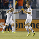 CORRECTS BYLINE IN CAPTION - Los Angeles Galaxy's Landon Donovan, right, celebrates a goal by teammate Alan Gordon, along with teammate Marcelo Sarvas, left rear, against D.C. United during the first half of an MLS soccer match Wednesday, Aug. 27, 2014, i
