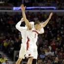 Wisconsin's Ben Brust (1) celebrates with a teammate during the second half of an NCAA college basketball game at the Big Ten tournament against MichiganFriday, March 15, 2013, in Chicago. Wisconsin won 68-59. (AP Photo/Nam Y. Huh)