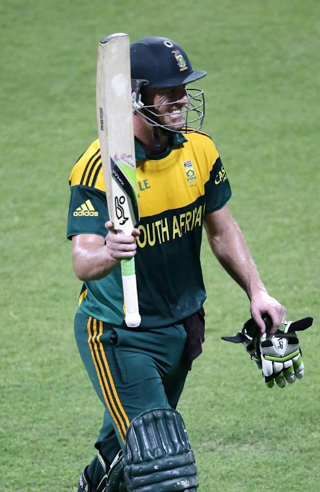 South Africa's AB de Villiers raises his bat to the crowd after scoring a century during the fifth cricket one-day international match of a five match series between Pakistan and South Africa at Sharjah Cricket Stadium, in Sharjah , United Arab Emirates, Monday, Nov. 11, 2013