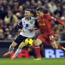Liverpool's Joe Allen, right, and Norwich City's Wesley Hoolahan battle for the ball during their English Premier League soccer match at Anfield in Liverpool, England, Wednesday Dec. 4, 2013