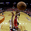 Houston Rockets' Dwight Howard (12) reaches for a rebound with Portland Trail Blazers' Robin Lopez, rear, during the second half in Game 1 of an opening-round NBA basketball playoff series Sunday, April 20, 2014, in Houston. The Trail Blazers won 122-120