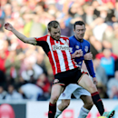 Sunderland's Seb Larsson, left, vies for the ball with Everton's Aiden McGeady, right, during their English Premier League soccer match at the Stadium of Light, Sunderland, England, Sunday, Nov. 9, 2014