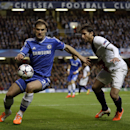 Chelsea's Branislav Ivanovic, left, and PSG's Maxwell go for the ball during the Champions League second leg quarterfinal soccer match between Chelsea and Paris Saint-Germain at Stamford Bridge Stadium in London, Tuesday, April 8, 2014