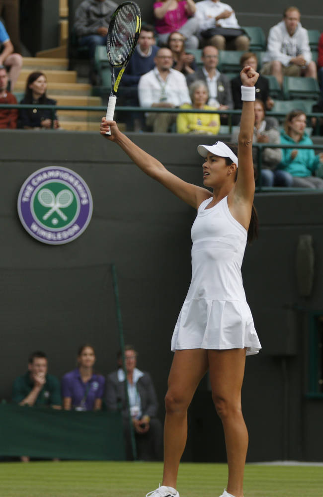 Ana Ivanovic of Serbia celebrates after defeating Francesca Schiavone of Italy during their first round match at the All England Lawn Tennis Championships in Wimbledon, London, Tuesday, June 24, 2014