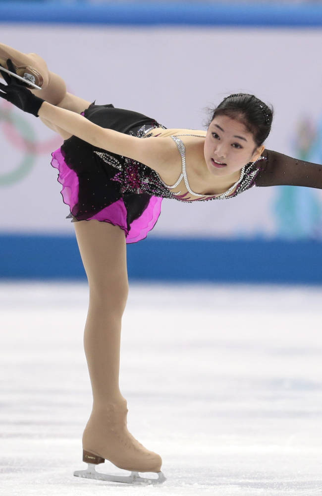 Li Zijun of China competes in the women's short program figure skating competition at the Iceberg Skating Palace during the 2014 Winter Olympics, Wednesday, Feb. 19, 2014, in Sochi, Russia