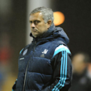 Chelsea manager Jose Mourinho watches hies team during the Fourth Round of the English League Cup soccer match between Shrewsbury Town and Chelsea at Greenhous Meadow, Shrewsbury, England, Tuesday, Oct. 28, 2014