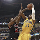 In this March 21, 2014 file photo, Indiana Pacers forward Paul George (24) shoots over Chicago Bulls guard Jimmy Butler in the second half of an NBA basketball game in Indianapolis. George has the pedigree to make it big in the NBA. But the question remai